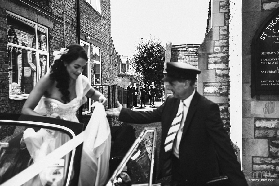 Bride exiting the car at Wedding in St Thomas Canterbury church