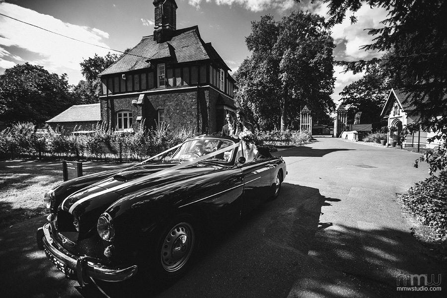 bride and groom entering Fulham Palace with Bristol convertible