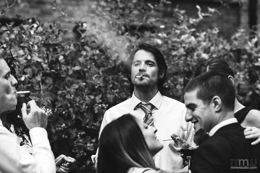 wedding guests smoking cigarettes portrait