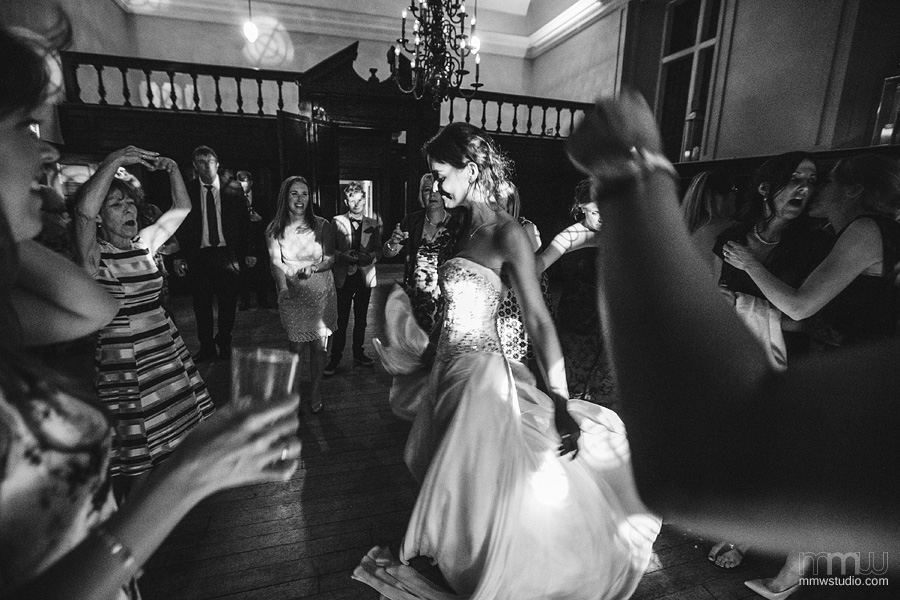 natural black and white photography dancing bride