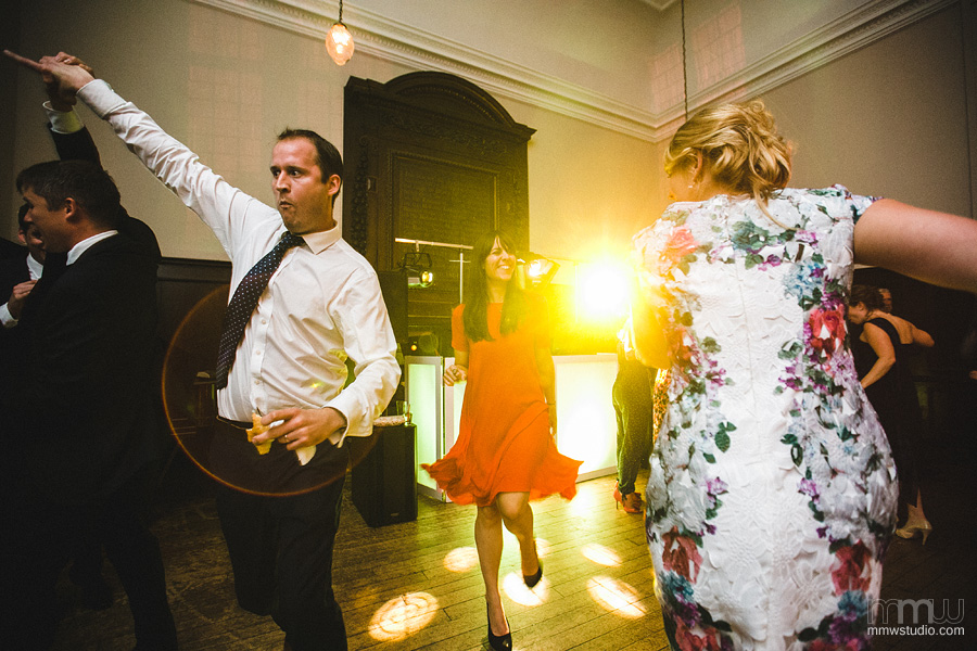informal wedding reception shots, lens flare