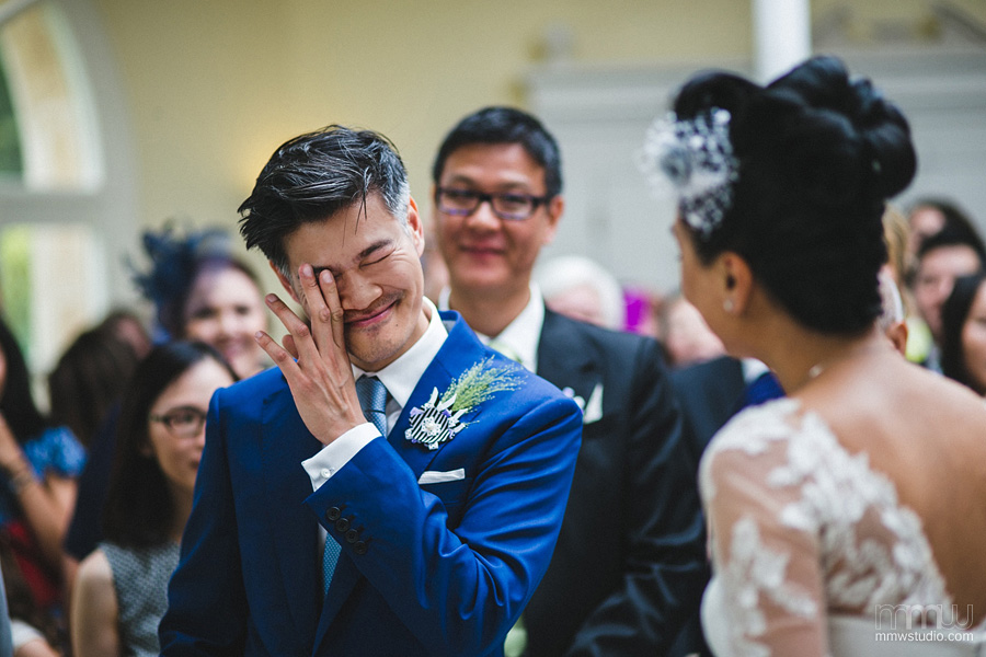 crying groom portrait