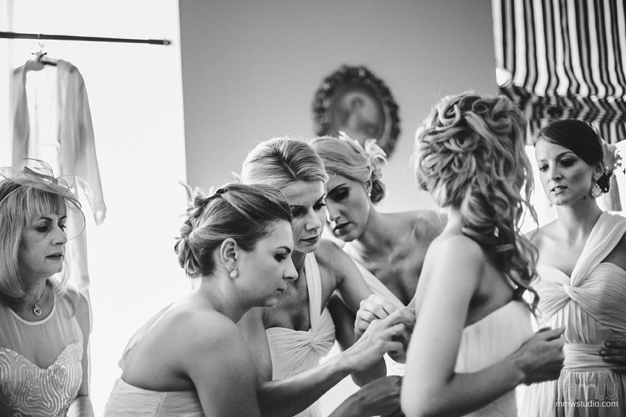 bridesmaids helping the bride on preparations