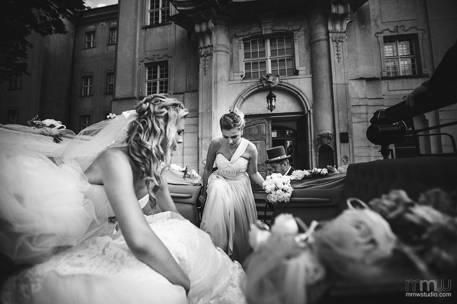 bride in the wedding carriage