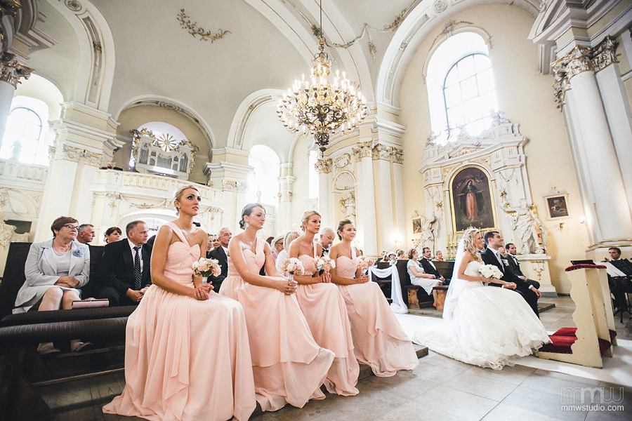 bridesmaids in the church, pink dresses