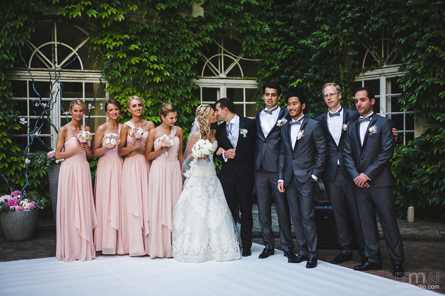 newly married couple with bridesmaid and groomsman