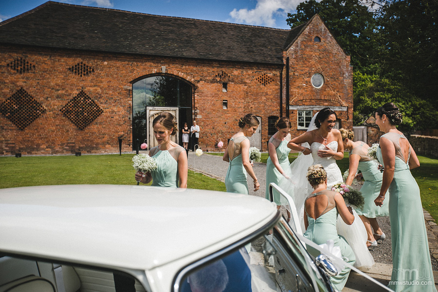 Shustoke Farm Barn Wedding photographer Birmingham, Solihull, Meriden. Bride in Mini
