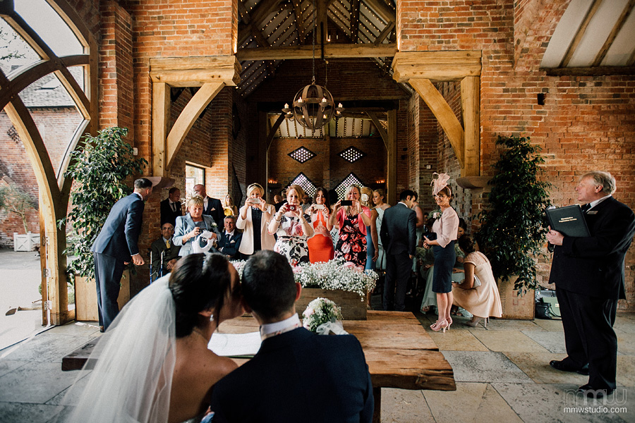 Candid inobtrusive wedding pictures. Shustoke Farm Barn Wedding photography