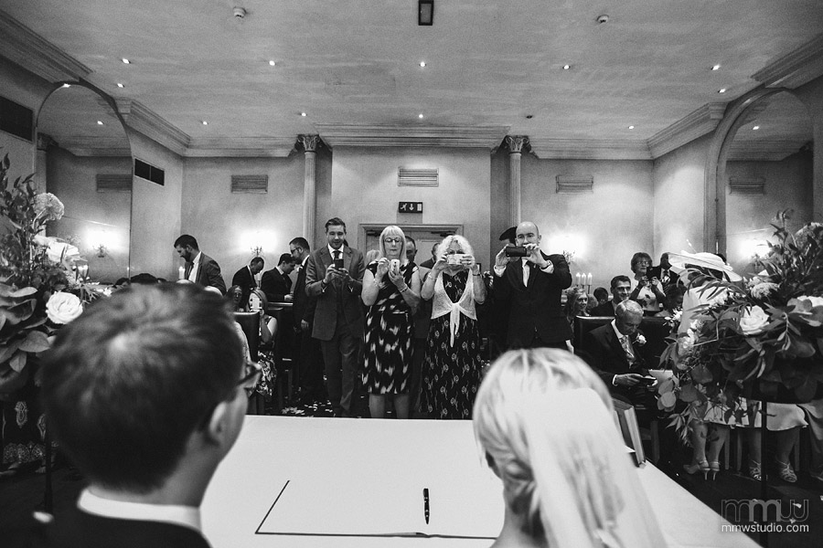 wedding guests with compact cameras