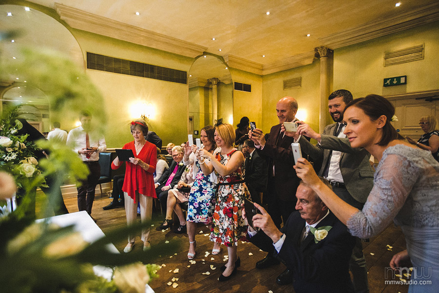 wedding guests as photographers